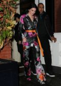 Kendall Jenner steps out in a satin floral pantsuit during New York Fashion Week in New York City