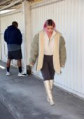 Kim Kardashian rocks snakeskin boots as she arrives at a warehouse in Los Angeles
