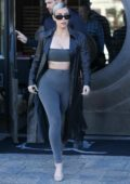 Kim Kardashian wears a black leather trench coat with tube top and matching leggings as she grabs lunch with Kris Jenner at a sushi restaurant in Los Angeles