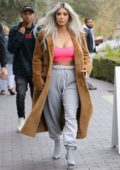Kim Kardashian wears a pink tube top and sweat pants to grab some flowers on Valentine's Day in Calabasas, California