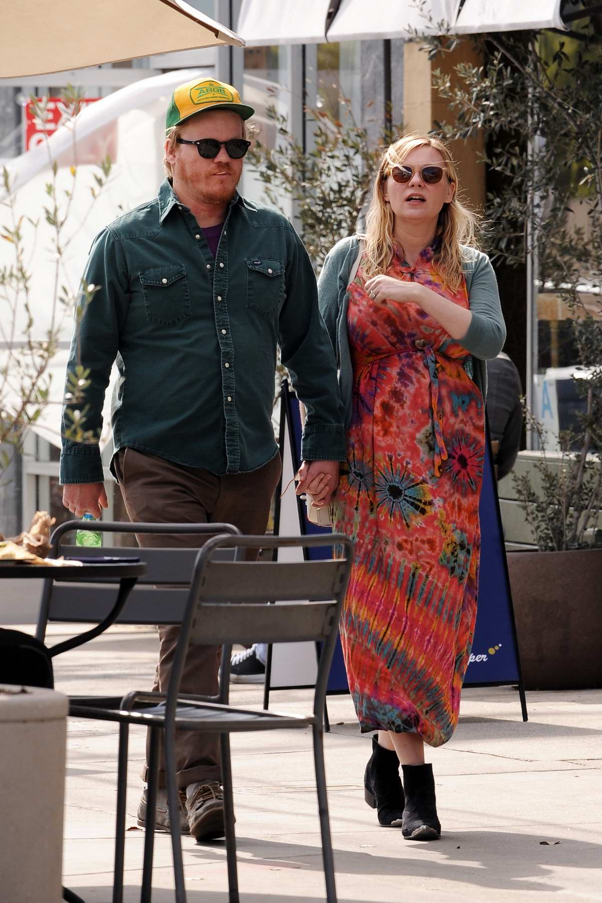 Kirsten Dunst wearing a summer orange dress while out for brunch with fiance Jesse Plemons at Proof Bakery in Atwater Village, Los Angeles