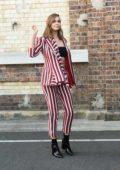 Ksenija Lukich wears stripes during a photoshoot in Sydney, Australia