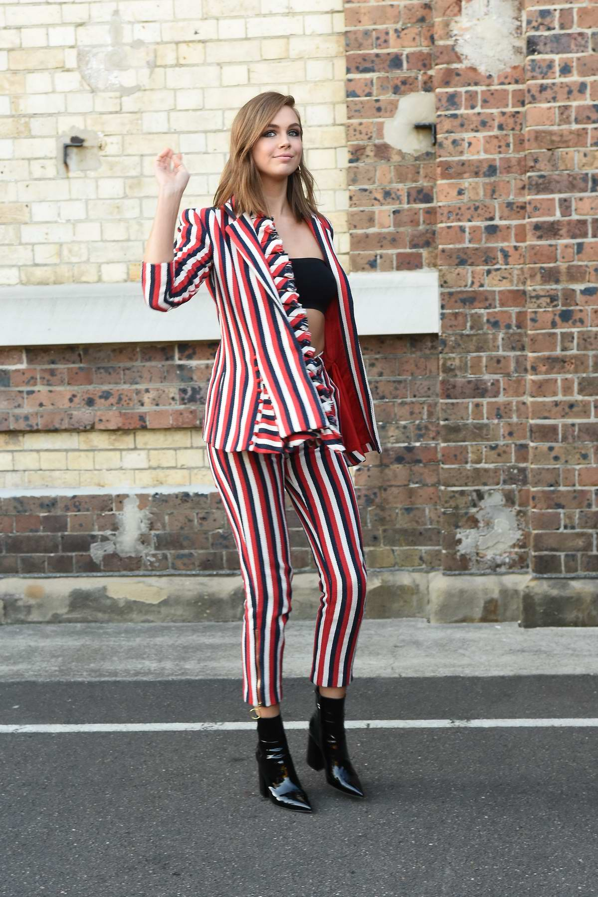 Ksenija Lukich wears stripes during a photoshoot in Sydney, Australia