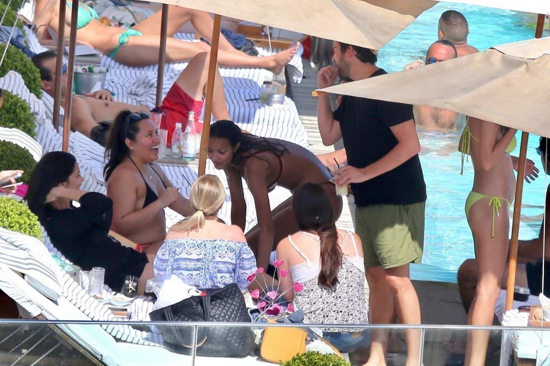 Lais Ribeiro and Adriana Lima lounge at Fasano's pool in Rio de Janeiro, Brazil