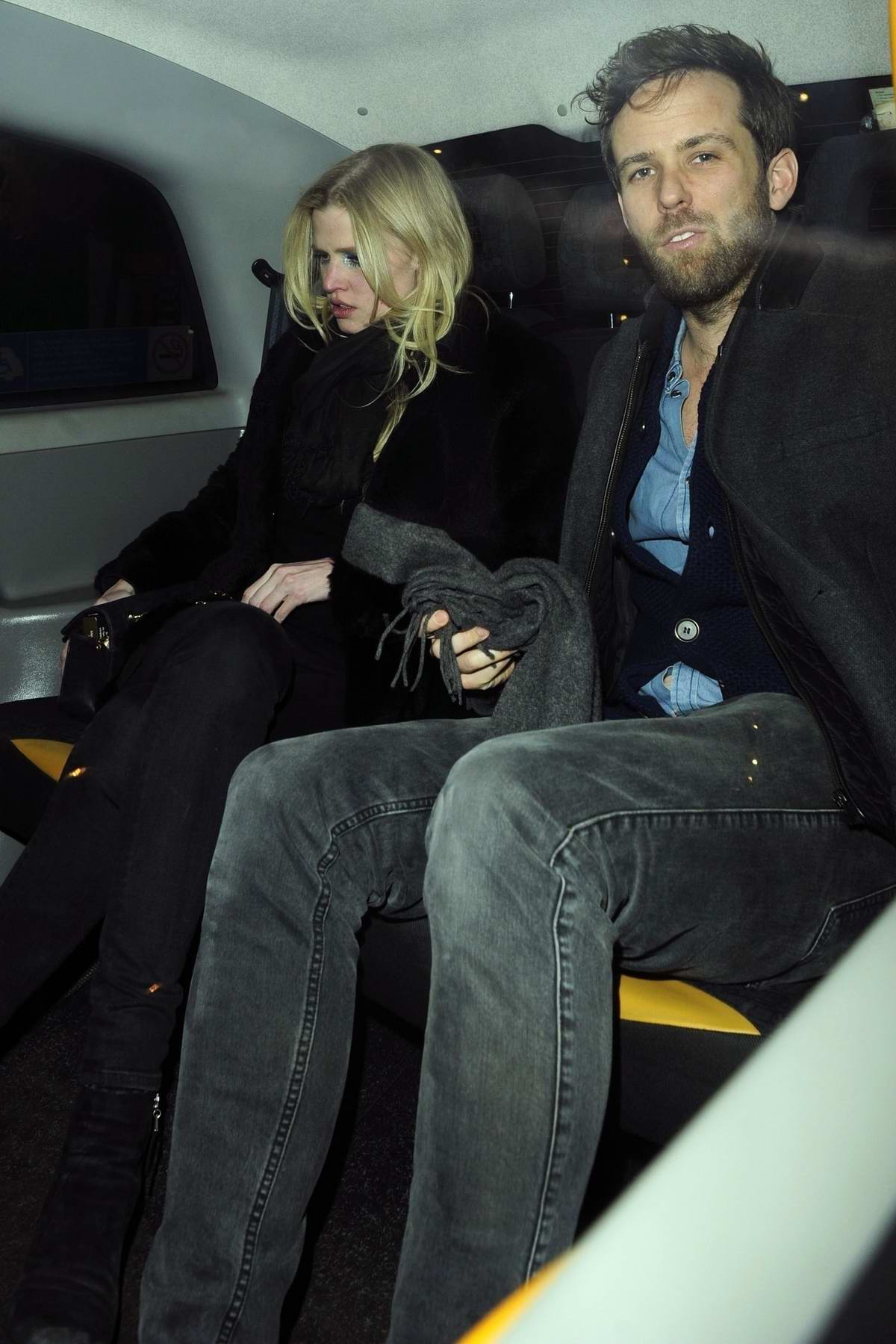 Lara Stone leaves Soho House Private Members Club with a male friend in London