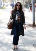 Lily Collins makes a morning coffee run at Starbucks in West Hollywood, Los Angeles