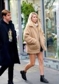Lottie Moss wore a short black skirt with a beige Sherpa jacket while out with a friend at Kings Road in Chelsea, London
