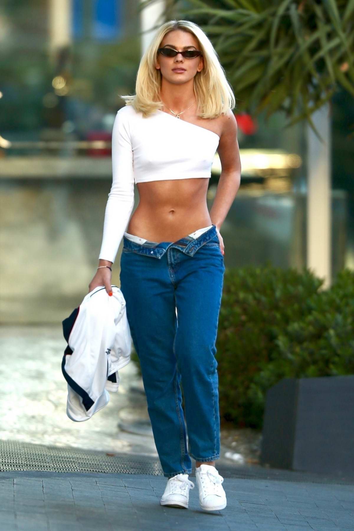 Louisa Johnson shows off her toned abs in a white crop top and low waist jeans while out in Los Angeles