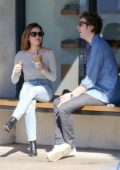 Lucy Hale grabs coffee with a friend at Alfred's Cafe in Los Angeles