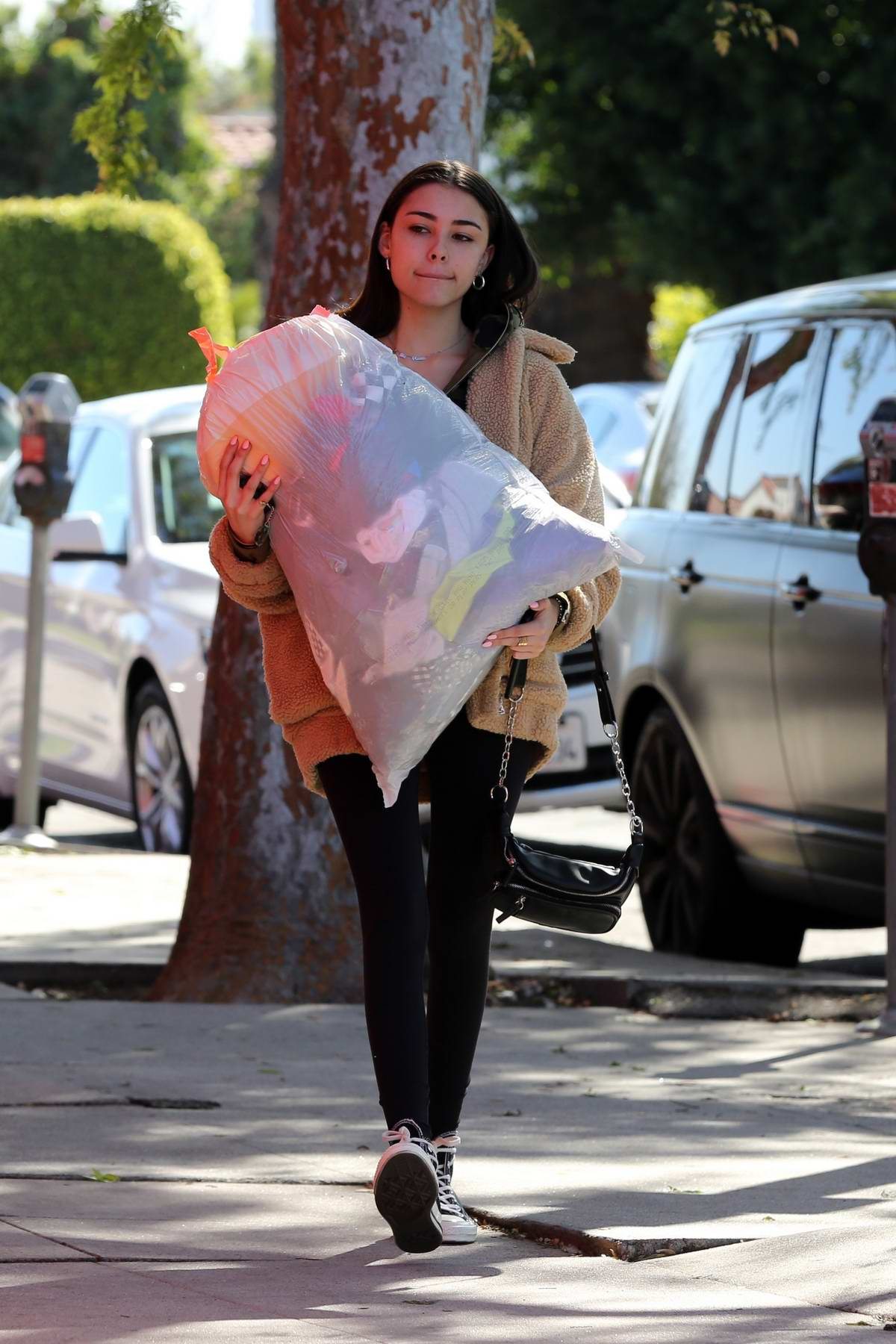 Madison Beer spotted while she drops off a big bag of clothes to charity in Los Angeles