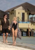 Malin Akerman wears a black swimsuit as she take a romantic walk on the beach with her finance in Mexico
