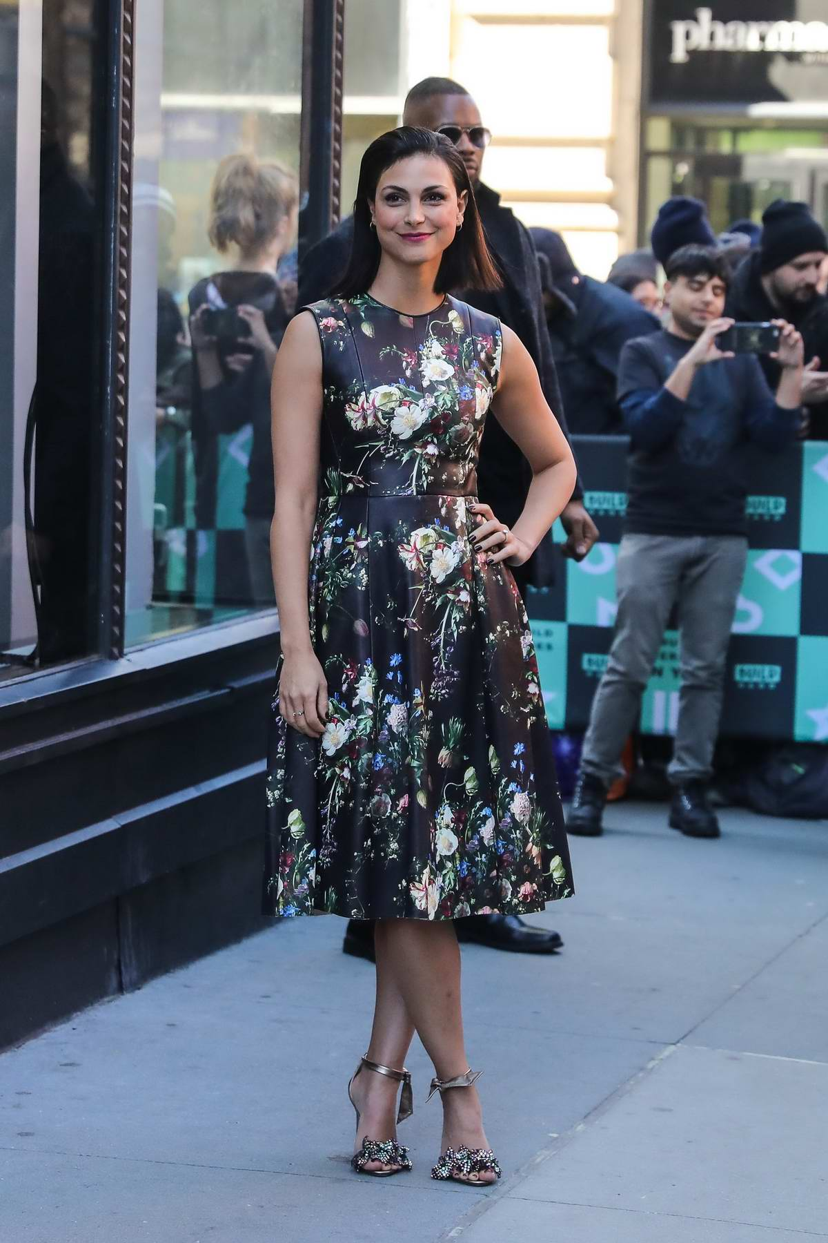 Morena Baccarin pose outside AOL Build Speaker Series in New York City
