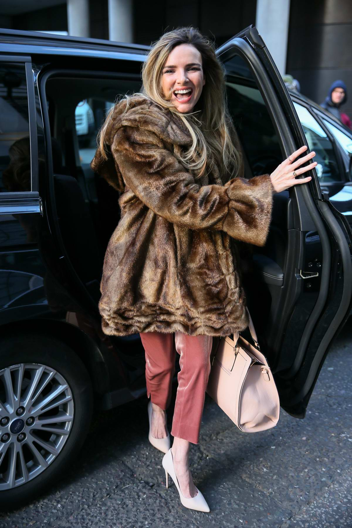 Nadine Coyle arrives at the AOL building in London
