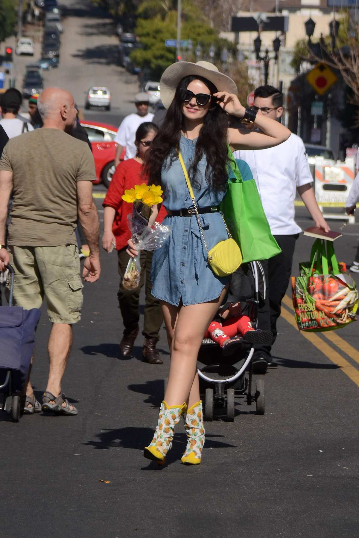 Natasha Blasick spotted in a short denim dress and a sunhat while shopping at the farmers market in Hollywood, Los Angeles