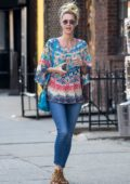 Nicky Hilton wears a colorful top and blue jeans while out on a stroll in New York City
