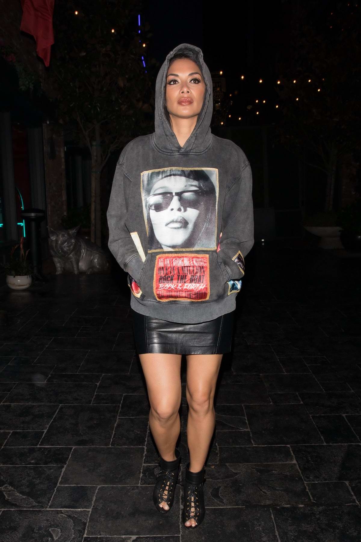 Nicole Scherzinger rocks a grey Aaliyah hoodie with a short leather skirt as she arrives to Avenue club in Hollywood, Los Angeles