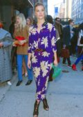 Nina Agdal wearing a blue floral pantsuit to the Zadig & Voltaire Show during New York Fashion Week in New York City