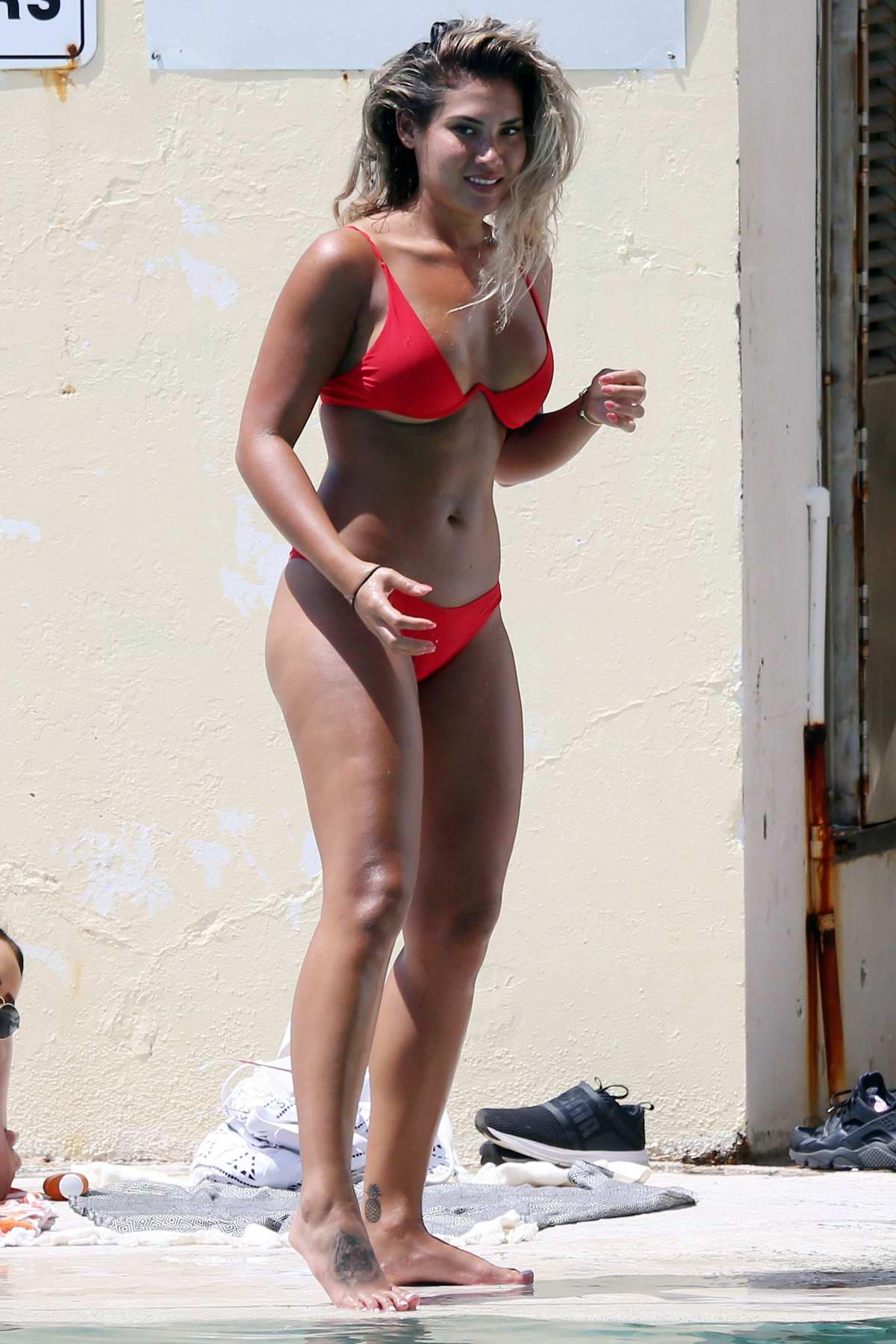 Noni Janur wears a red bikini while she enjoy the pool in Sydney, Australia