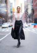 Olivia Culpo wearing Nina Ricci with a Salvatore Ferragamo handbag in Soho, New York City