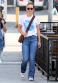 Olivia Wilde keeps it simple in white top and blue jeans as she heads to a lunch with a friend in Los Angeles