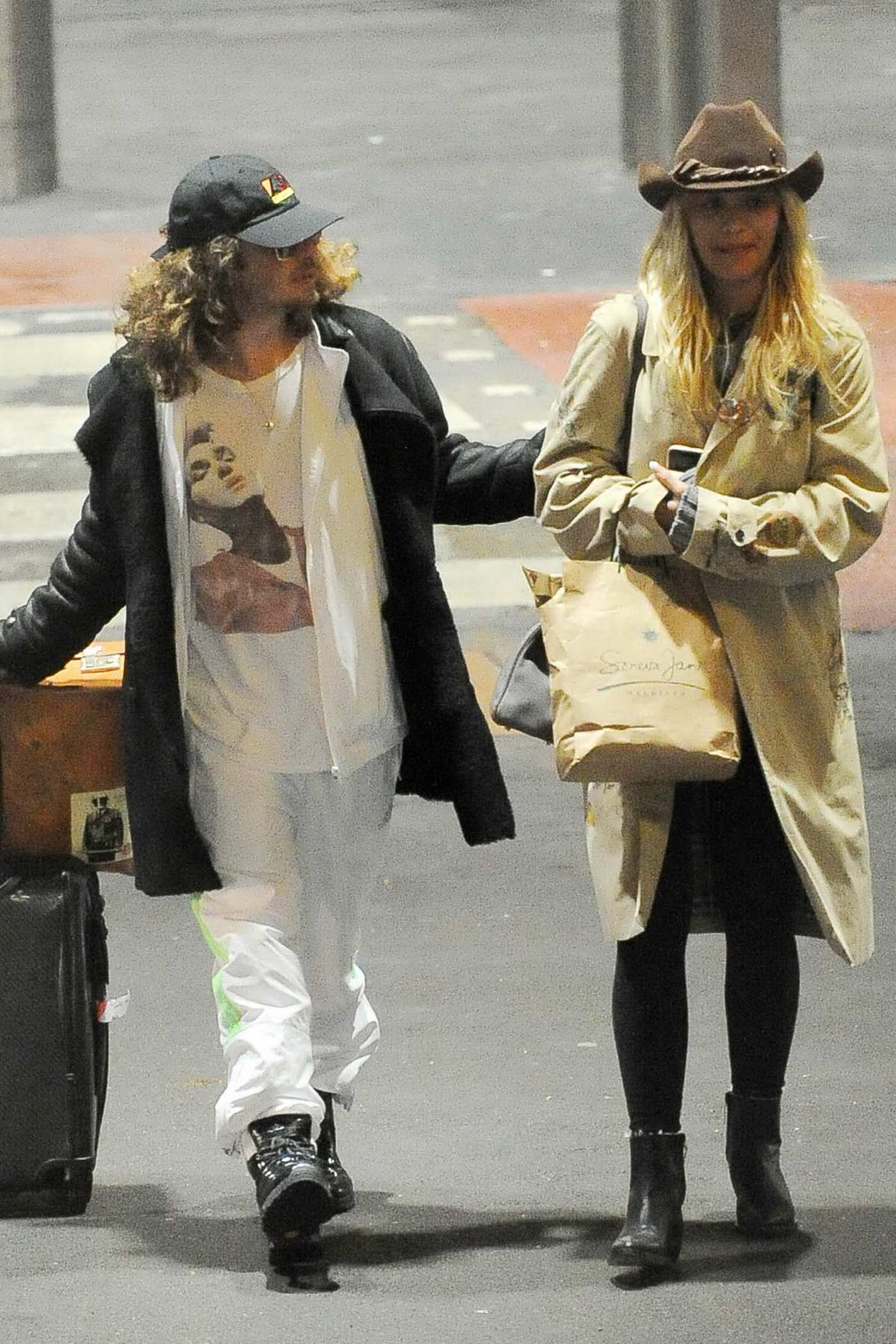 Rita Ora and boyfriend Andrew Watt arrives at Heathrow airport in London