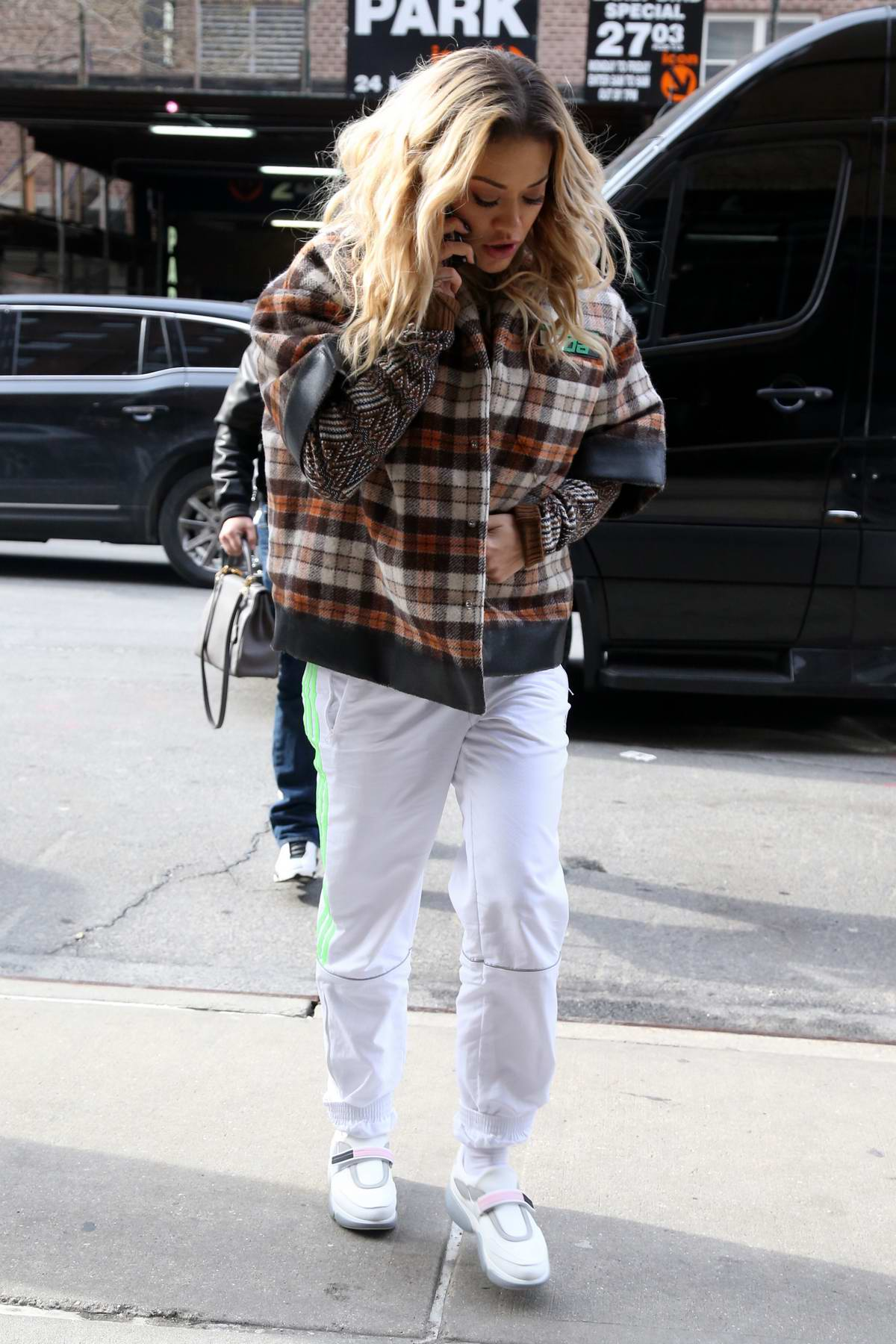 Rita Ora dons plaid as she arrives at The Greenwich Hotel in New York City