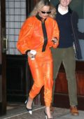Rita Ora in an all orange outfit heads to 'The Late Night With Seth Meyers' in New York