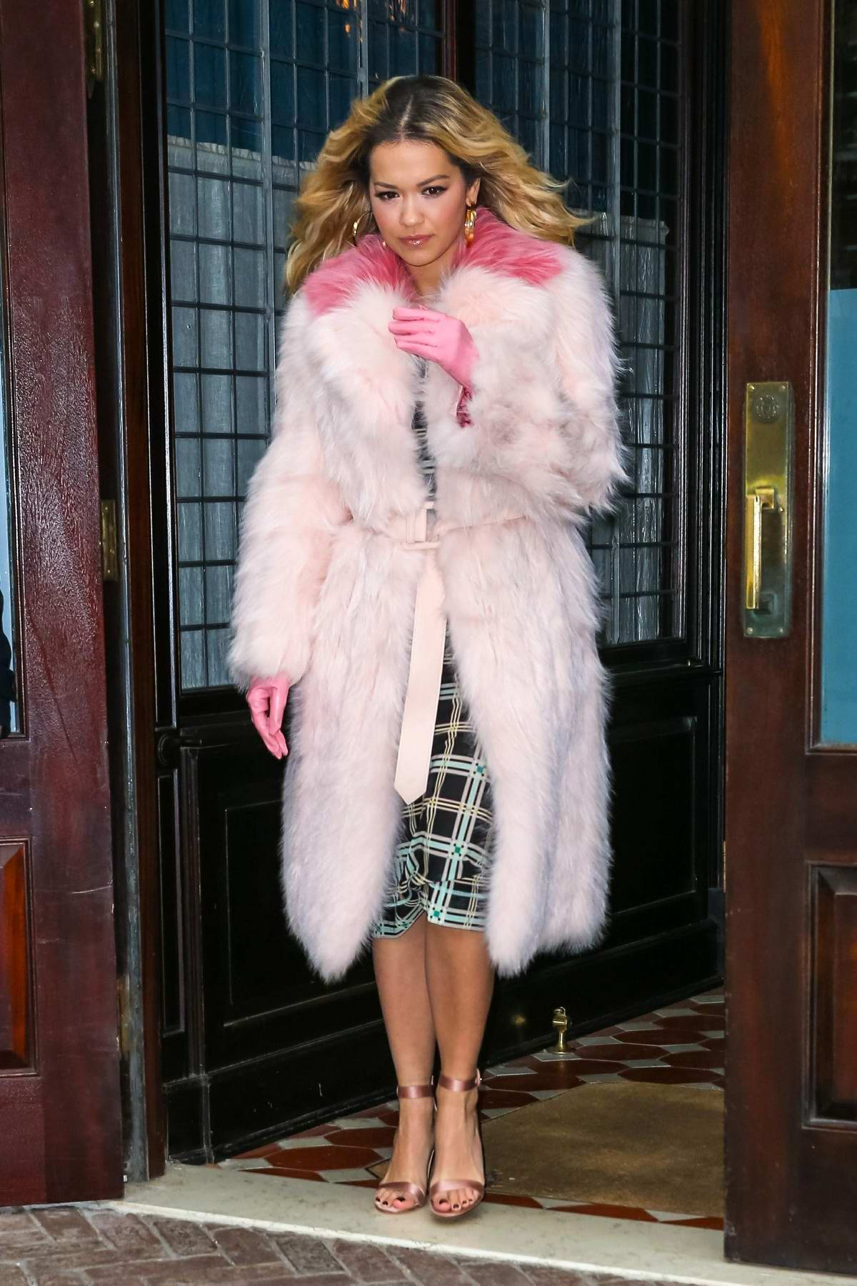 Rita Ora spotted as she leaves 'The Tonight Show Starring Jimmy Fallon' wearing a light pink fur trench coat in New York
