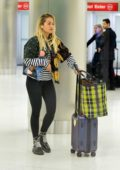 Rita Ora spotted with her luggage as she arrives at Miami airport, Florida