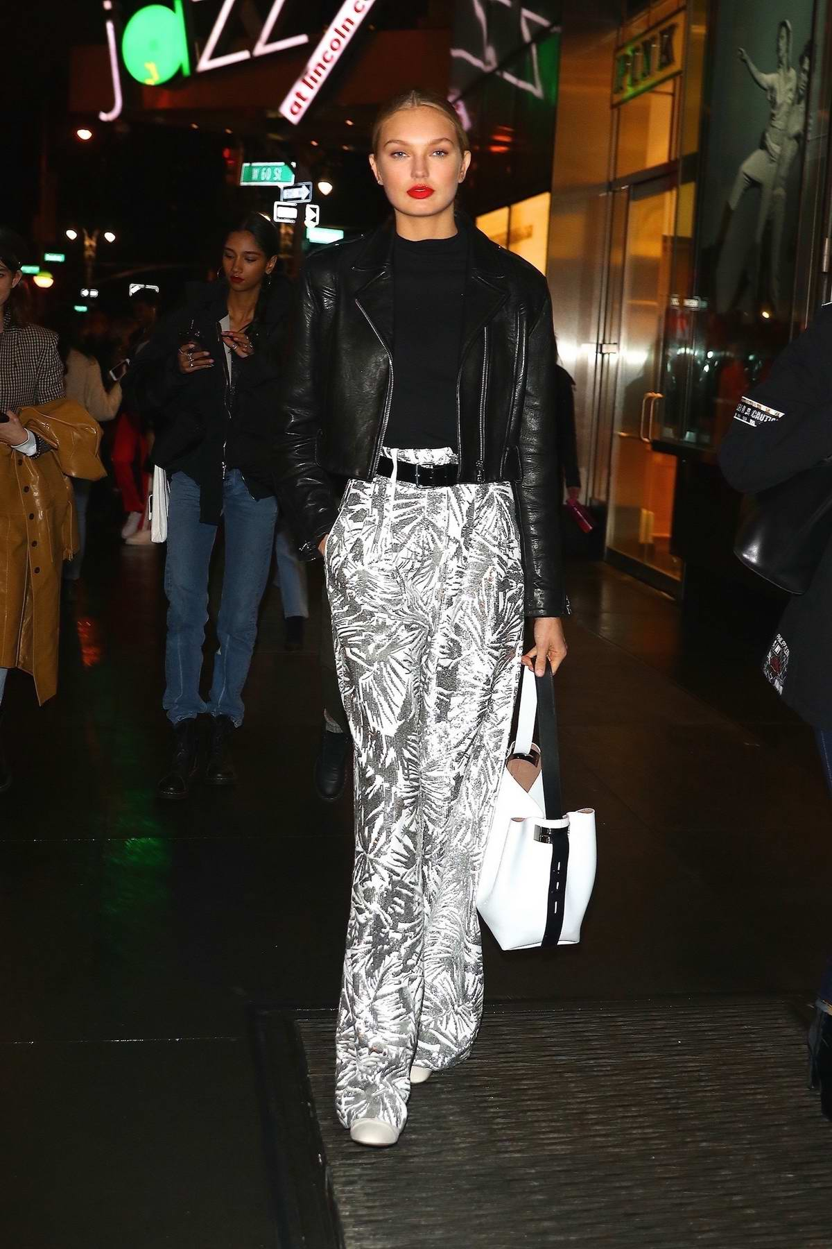 Romee Strijd wearing high waste print trousers and black leather jacket while out in New York City