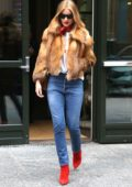Rosie Huntington-Whiteley leaves her hotel in fox fur jacket paired with blue jeans and red boots in New York City