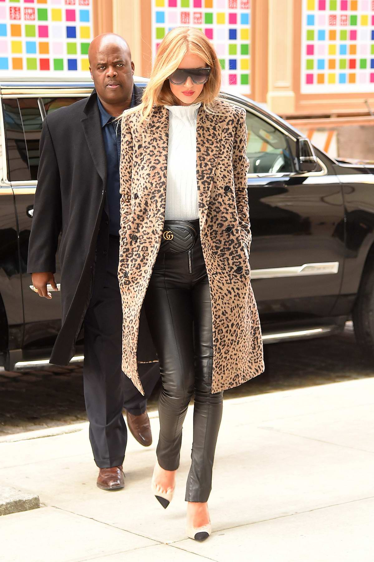 Rosie Huntington-Whiteley spotted in a leopard print trench coat and leather pants while out in Soho, New York City