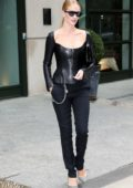 Rosie Huntington Whiteley wears black leather top with matching black trousers as she heads out of her hotel in New York City