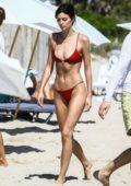 Sadie Newman in a red bikini enjoys a day on the beach in Miami, Florida