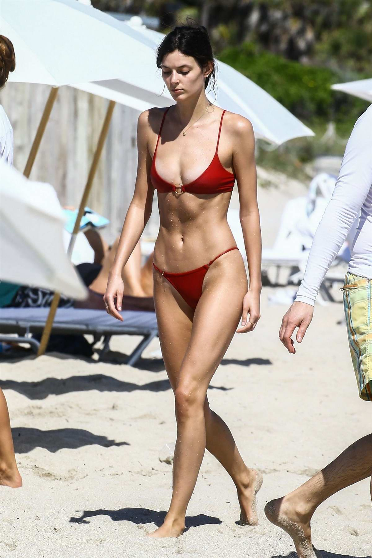 Sadie Newman in a red bikini enjoys a day on the beach in Miami, Florida