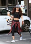 Sarah Hyland grabs an iced coffee after hitting the the gym in Los Angeles