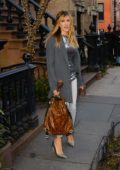 Sarah Jessica Parker wearing a grey coat over a shiny top while heading out in Soho, New York City