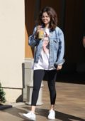 Selena Gomez looks casual but trendy as she steps out to get coffee with a friend in Studio City, Los Angeles