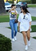 Selena Gomez visits a friends house wearing blue jeans and a New Kids On The Block tee in Los Angeles