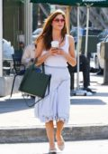 Selma Blair grabs a coffee while out wearing a pastel blue dress in Studio City, Los Angeles