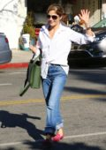 Selma Blair waves at the camera as she stopped to grab a coffee at Alfred's in Studio City, Los Angeles