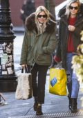 Sienna Miller wearing a fur lined parka with a Rag & Bone handbag while out with a friend in New York City
