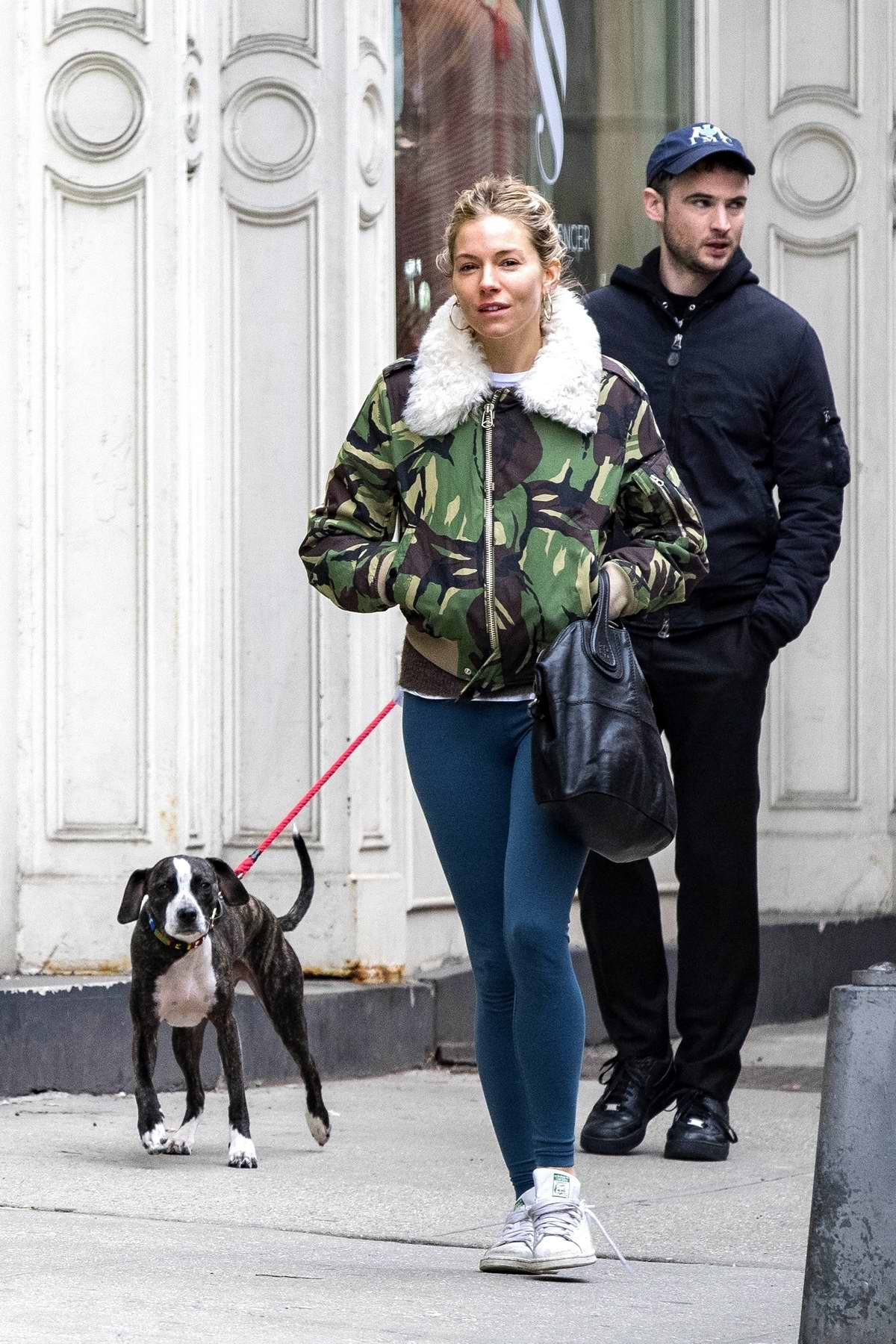 Sienna Miller wears a fur lined Camo jacket with blue leggings as she walks her dog with ex Tom Sturridge in West Village, New York City