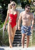 Sofija Milosevic wears a red bikini as she spends valentine's day with footballer Adem Ljajic on the beach in Miami, Florida