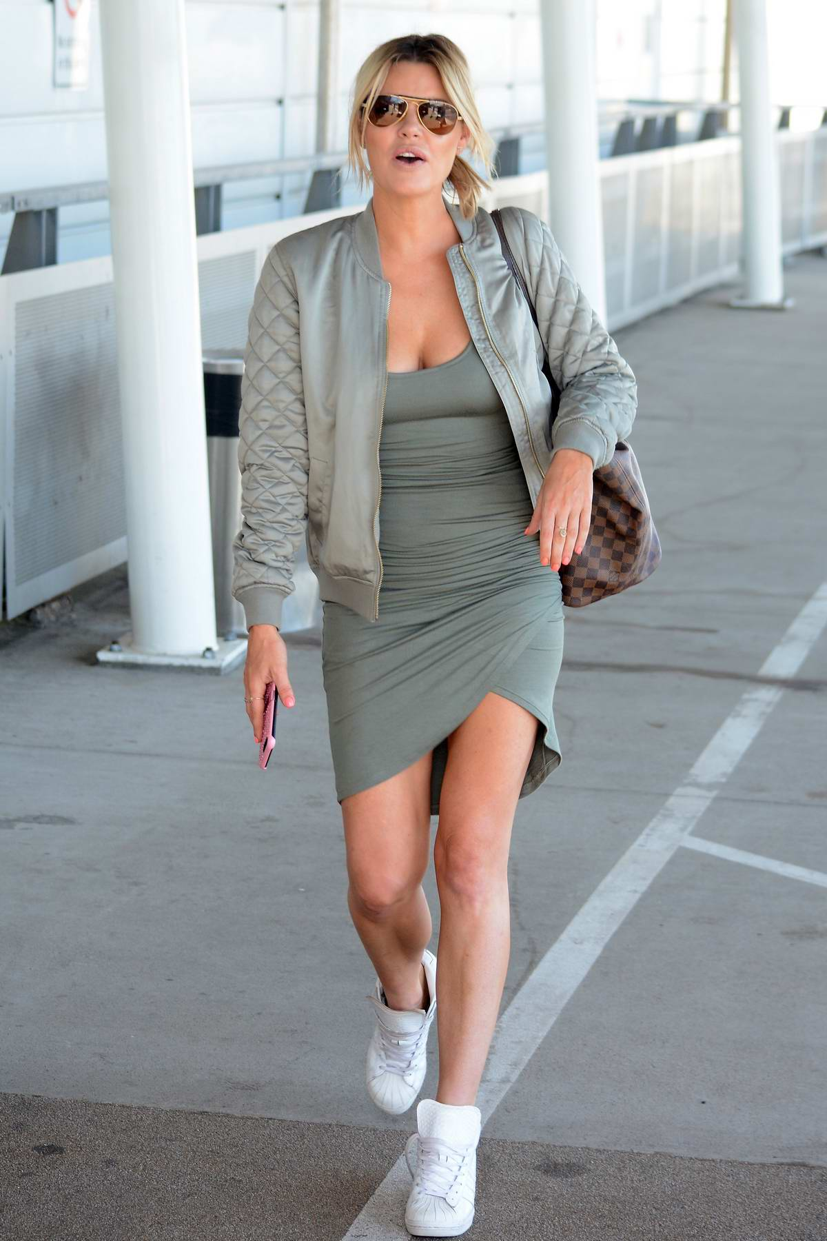 Sophie Monk has a quick smoke at the airport before she board her flight in Sydney