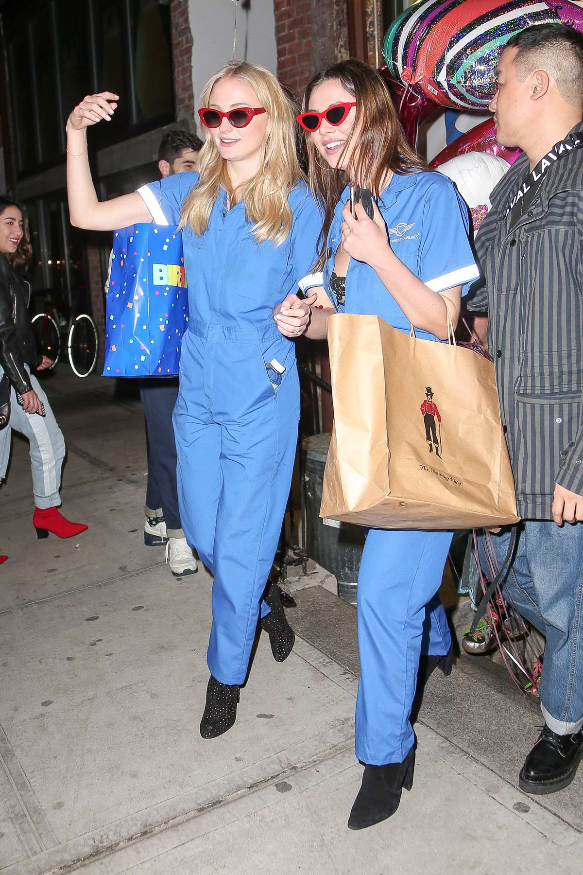 Sophie Turner and her friends wears matching blue jumpsuit as they leave SAMMYS restaurant after celebrating her 22nd birthday in New York City