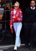 Sophie Turner looking stylish in a red flowered jacket as she leaves her hotel in New York City