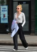 Sophie Turner wore black-and-white pinstriped pants with an unbuttoned top while out running errands in New York City