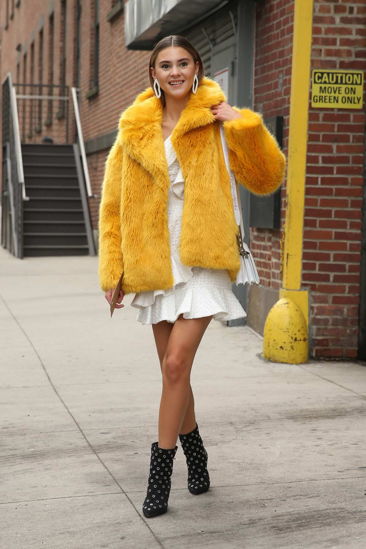 Stefanie Giesinger arrives for Self-Portrait A/W Show wearing a yellow faux fur jacket during New York Fashion Week in New York City