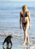 Stephanie Pratt looks stunning as she hits the beach in a black bikini in Malibu, California